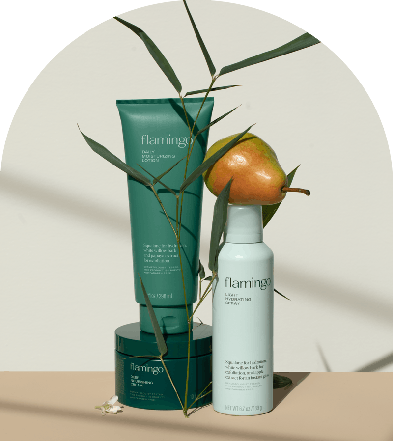 Daily moisturizing lotion, light hydrating spray, and deep nourishing cream surrounded by leaves and a pear