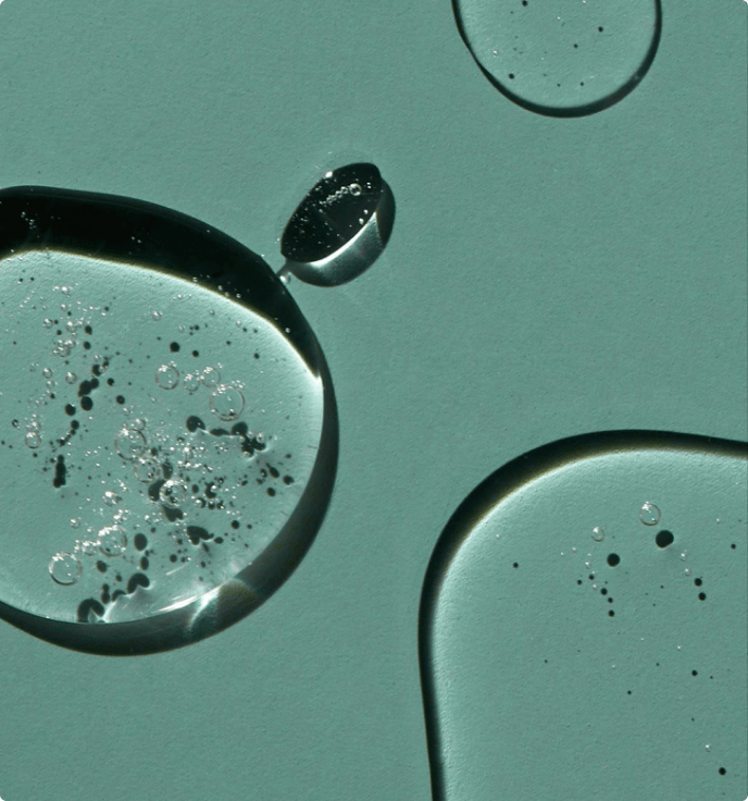 Water droplets on a green background
