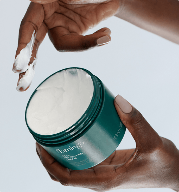Woman with deep nourishing cream on her fingers.