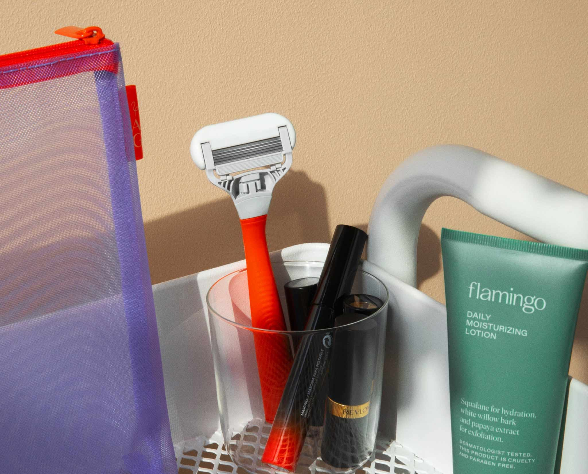 Razor in a bathroom surrounded by products