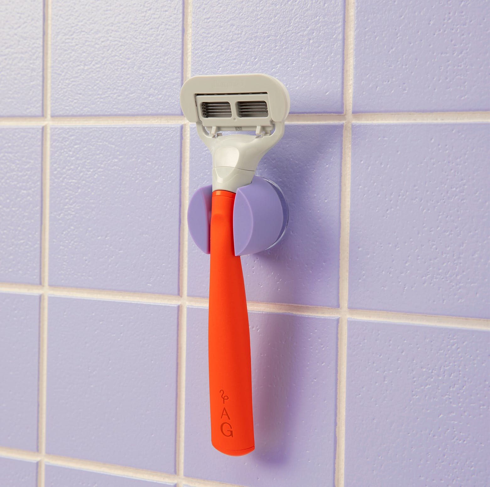 Razor hanging on a shower hook in the shower