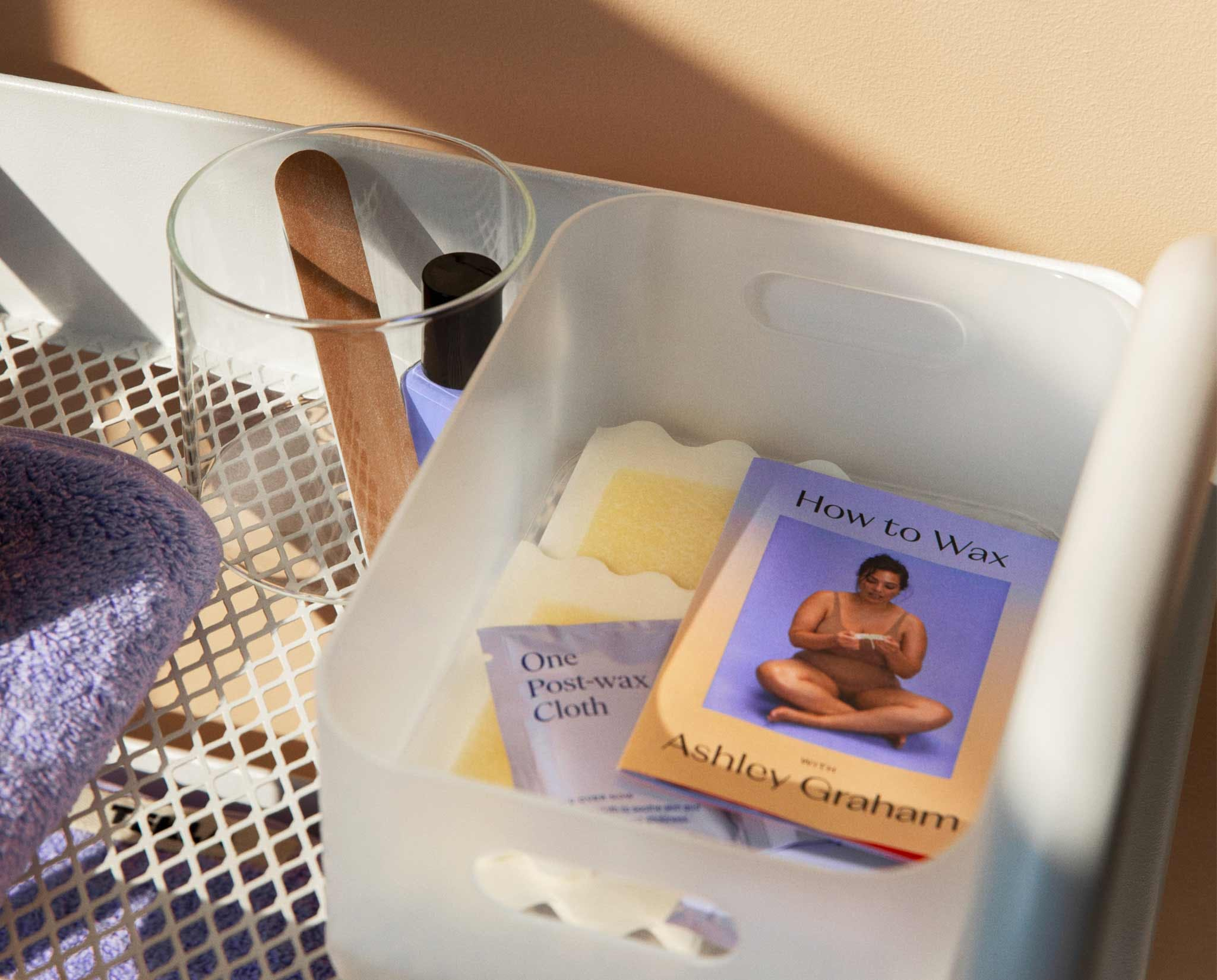 Ashley Graham wax kit comonents in a bin