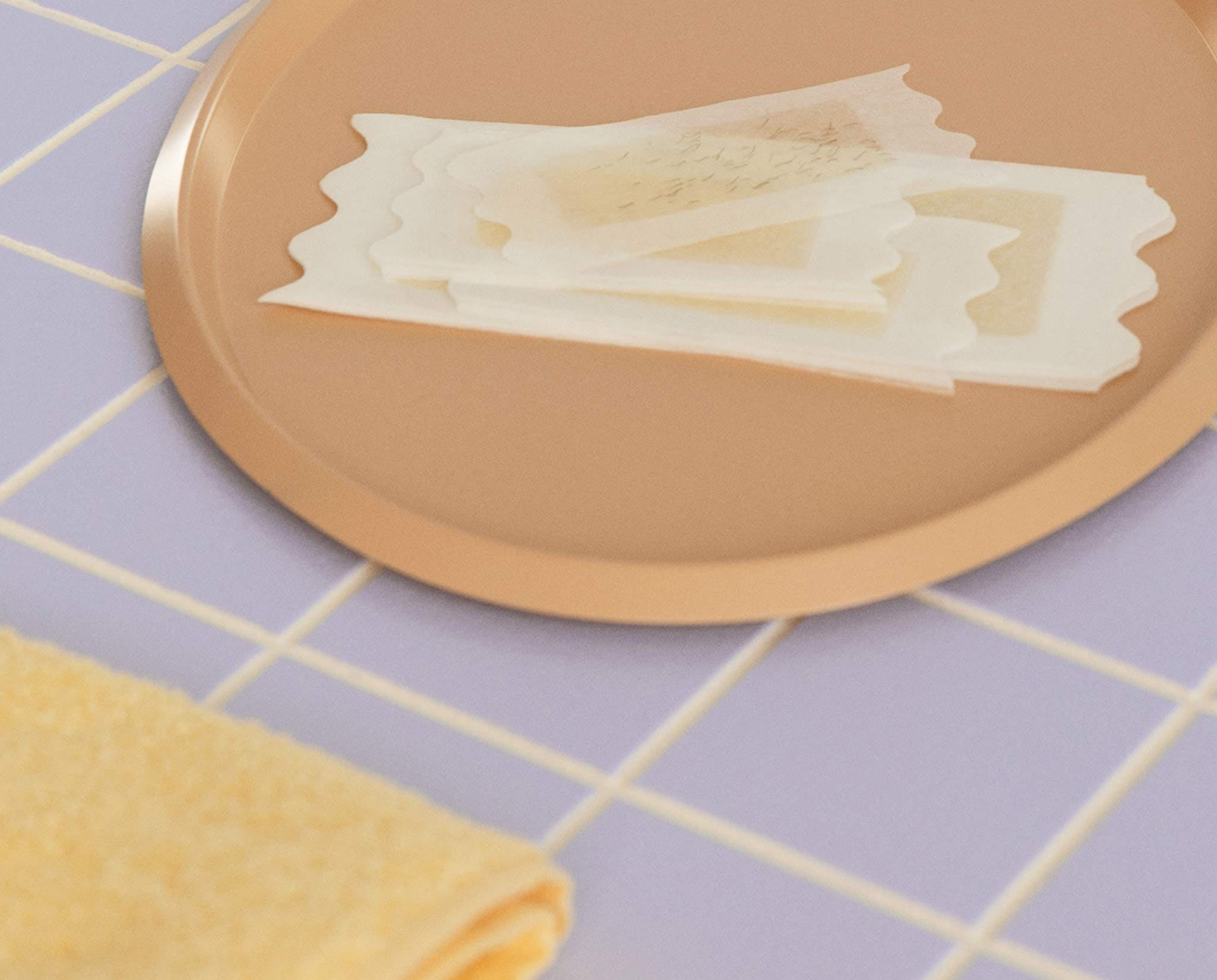 Used wax strips in a bathroom