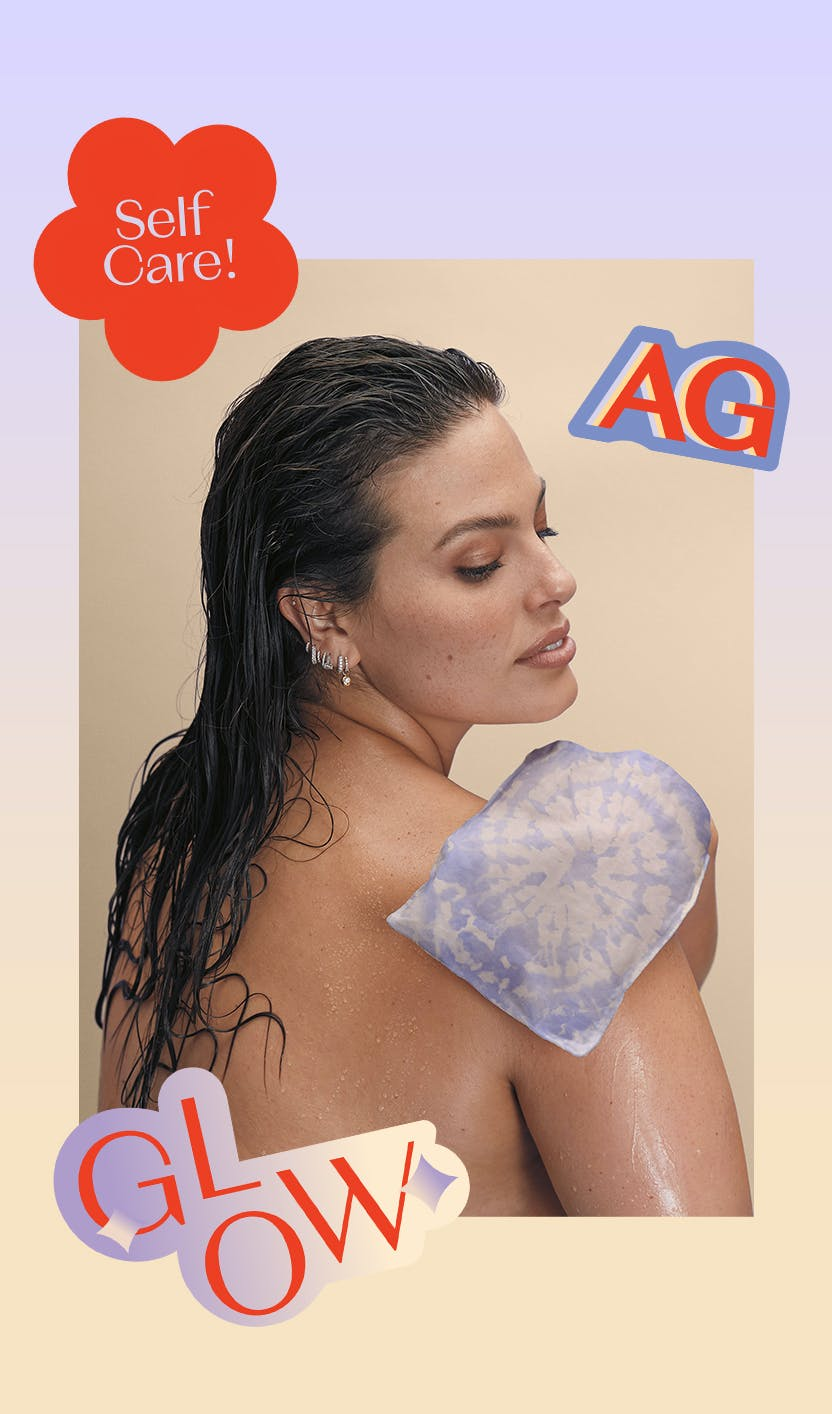 Ashley Graham using the exfoliating mitt on her shoulder