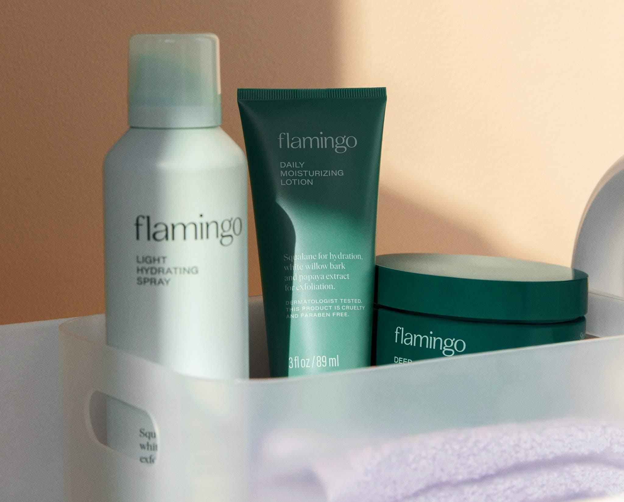 Light hydrating spray, daily moisturizing lotion, and deep nourishing cream in a bin