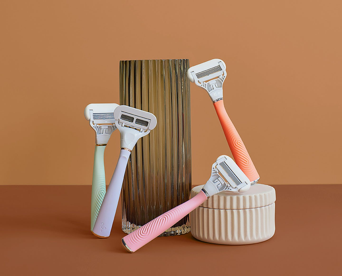 Four razors in different colors stacked