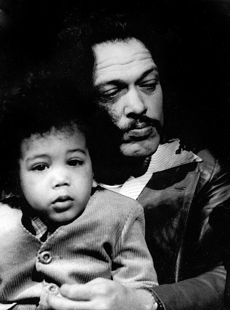 Lyman with his son Lyman III. Photo by Leni Sinclair.