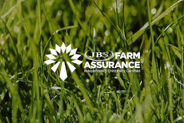 Farm Assurance logo over grass