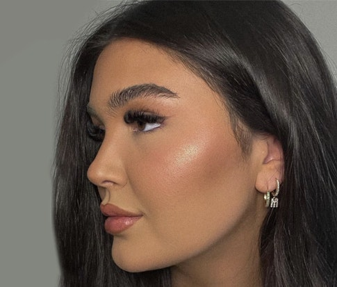 Woman showing left side of her face