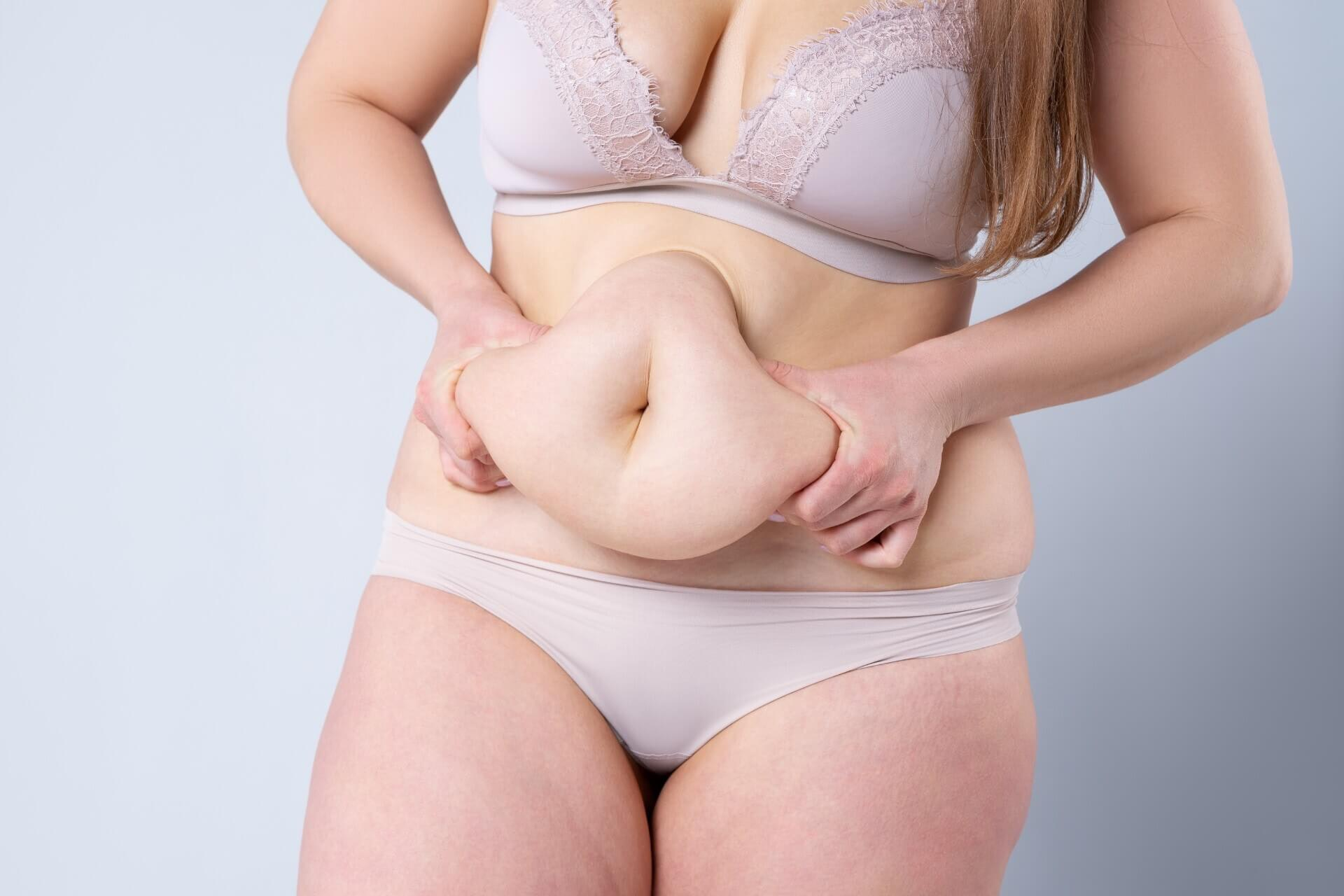 Woman grabbing her belly