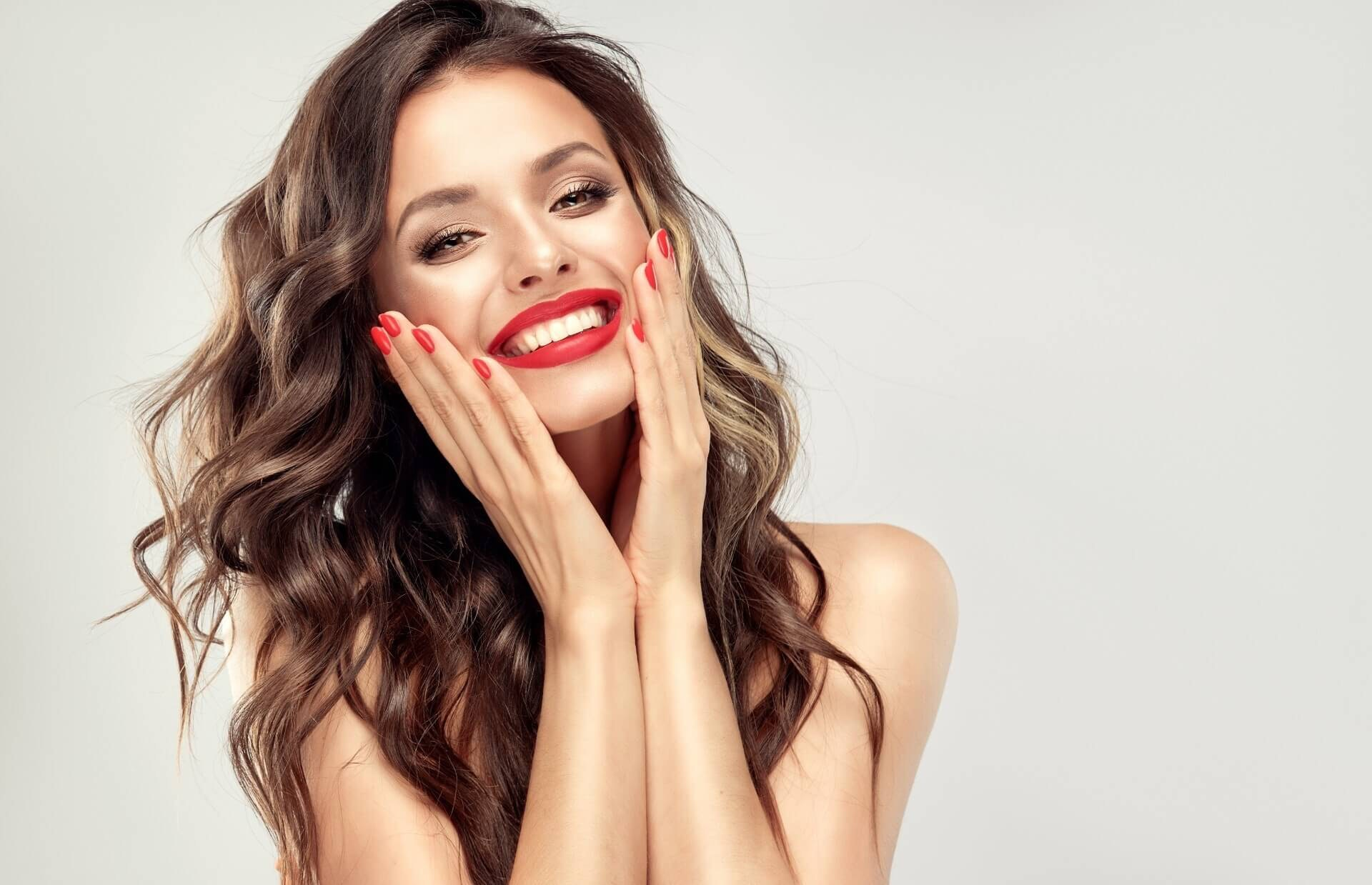 Woman smiling and touching her face