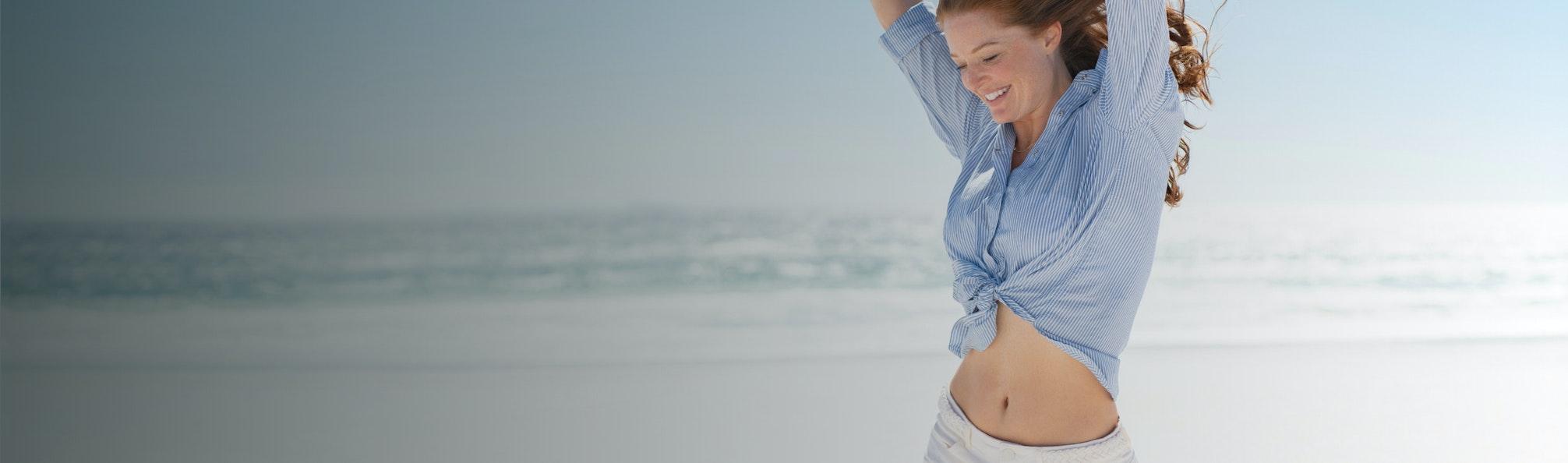 woman celebrating on the beach