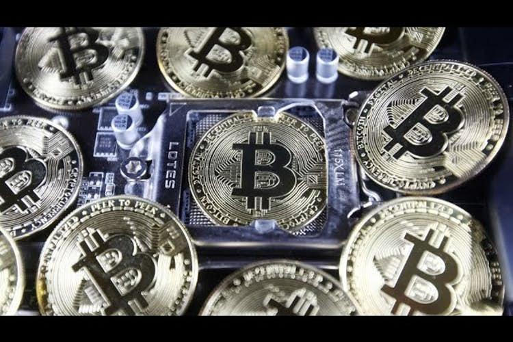 Ukraine adapts bitcoin; choosing a financial advisor; GameStop falls; Joe Theismann on the NFL
