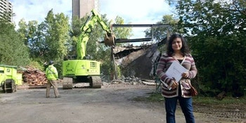 Sonia Menezes stands on the construction site of The Humber.
