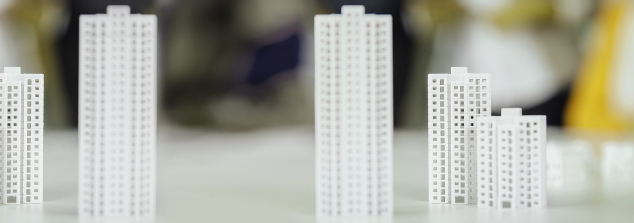 Models of high-rise buildings on table