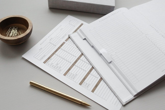 A budgeting worksheet sits atop a table