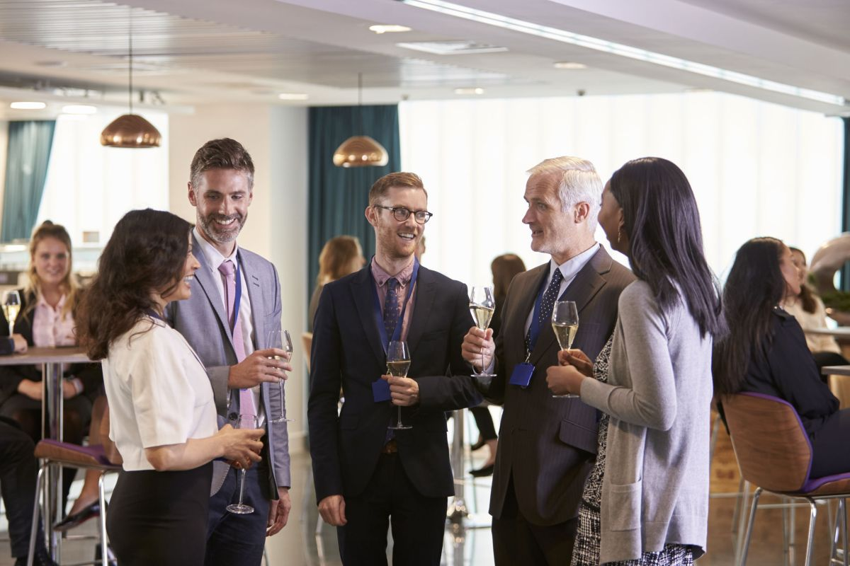 delegates networking at conference drinks reception|Business team discussing together plans|speaking