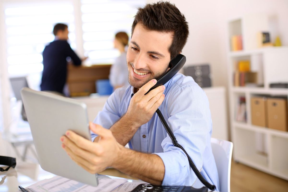 cheerful man in office answering the phone|agreement|contract