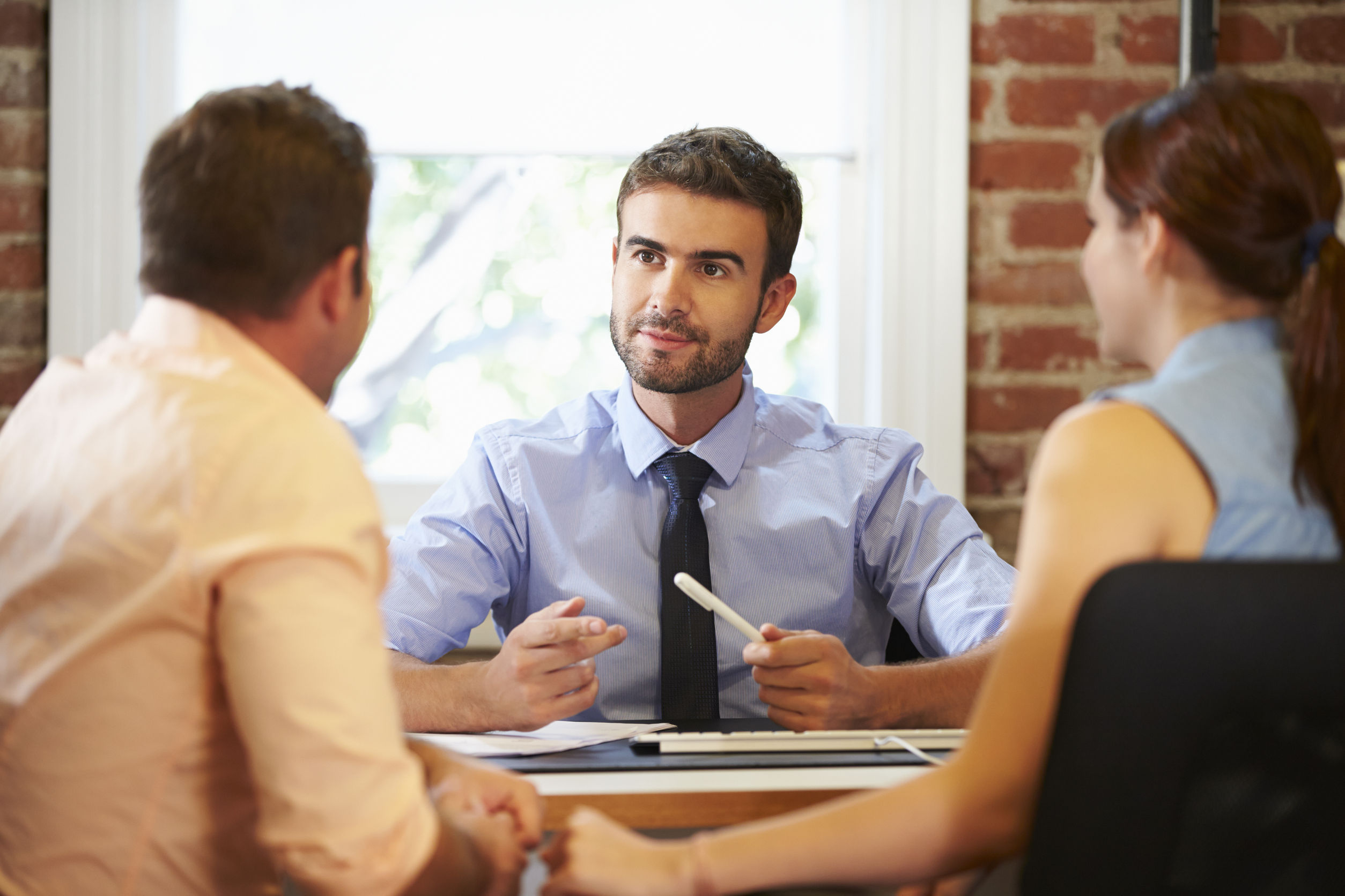 couple meeting with financial advisor in office brand loyalty marketing branding office working accounting concept meeting