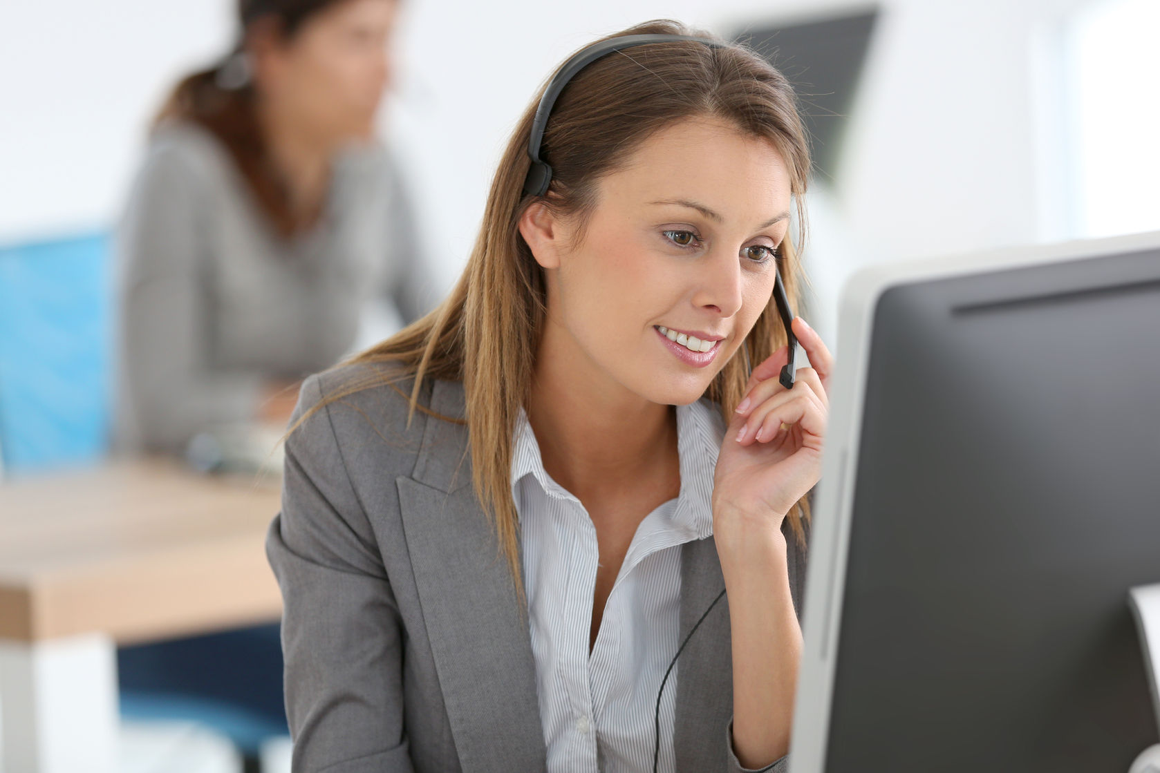 smiling customer service representative at work|feng shui flexibility|female hands with pen writing on notebook