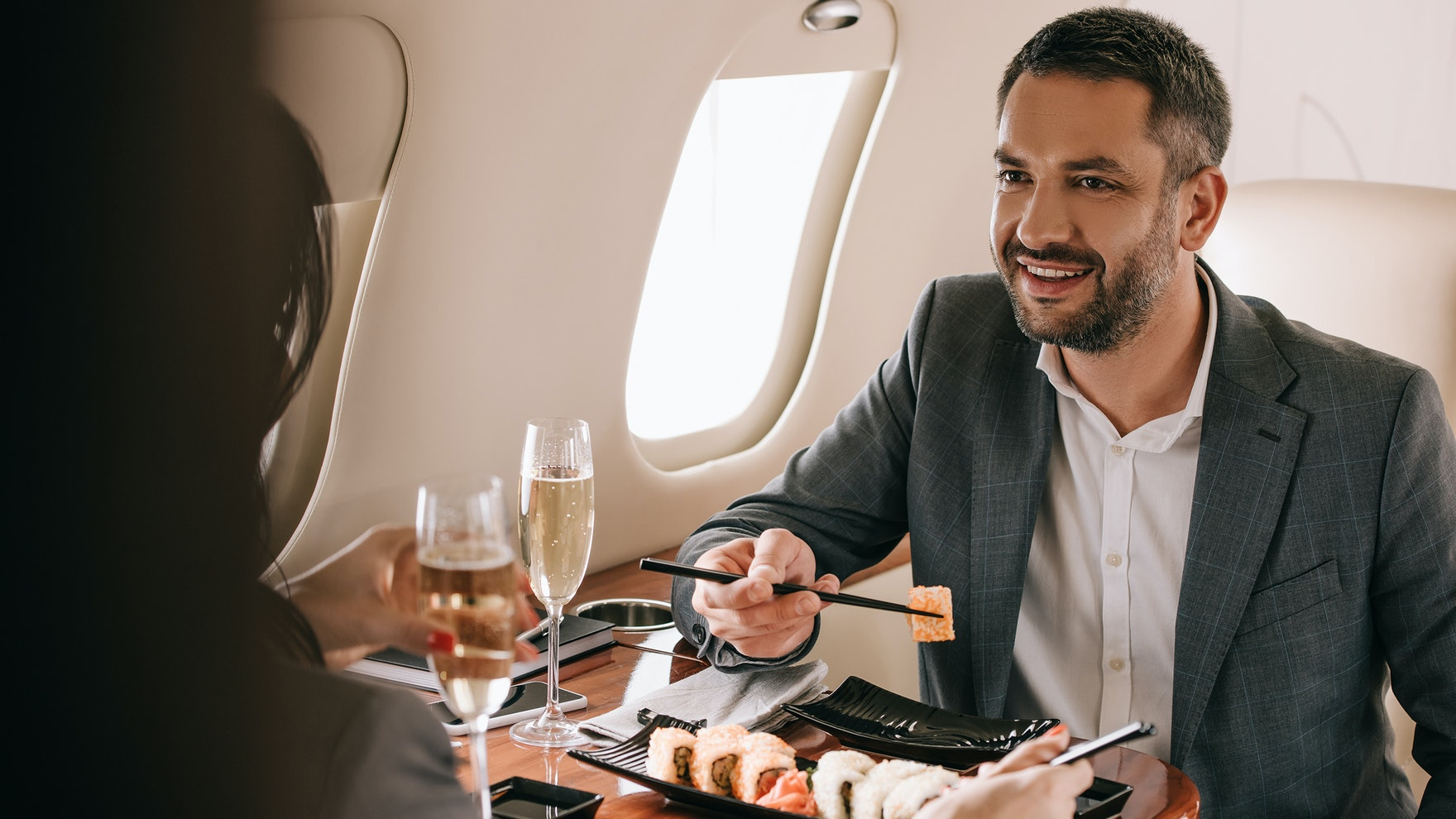 Photo Of Man Eating Sushi On Private Jet