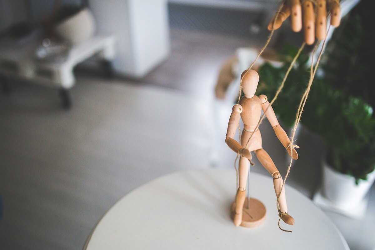 marionette with hand halding strings