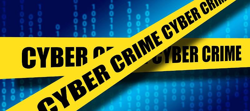the phrase cyber crime in police tape