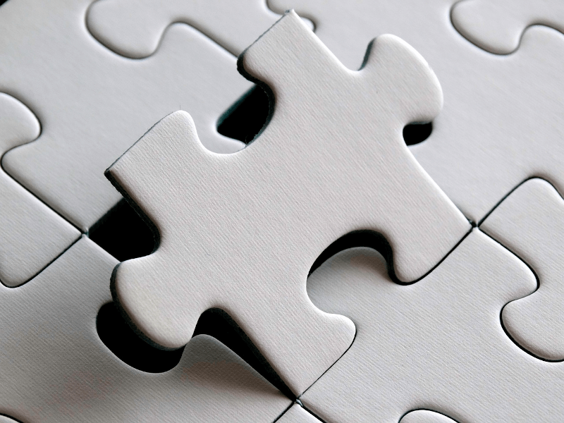 puzzle with one piece lifted