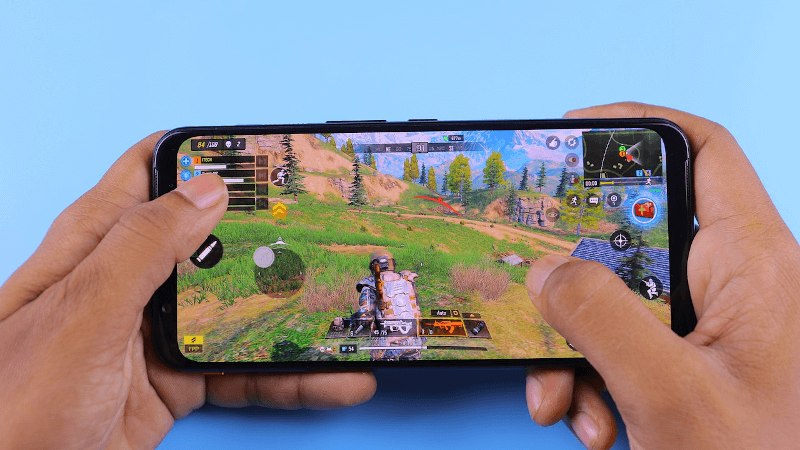 someone playing a mobile game on a phone