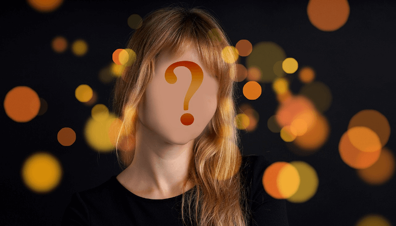 woman with blank face and question mark over it