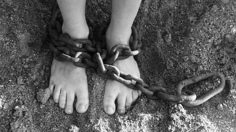 feet with chains on ankles