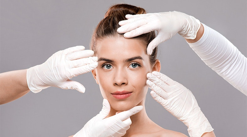 Attractive young woman getting treatment at beauty clinic