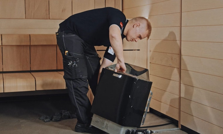 Man installing a electric heater