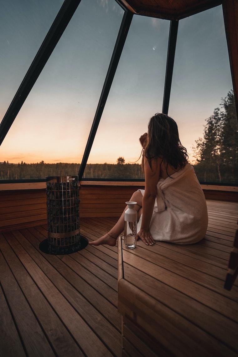 Lady in the Aurora Village sauna