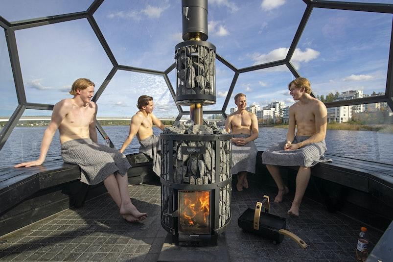 Group of men enjoying the sauna