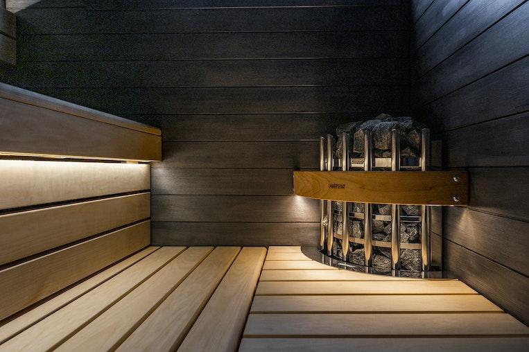 Harvia Glow corner heater with a illuminated safety railing