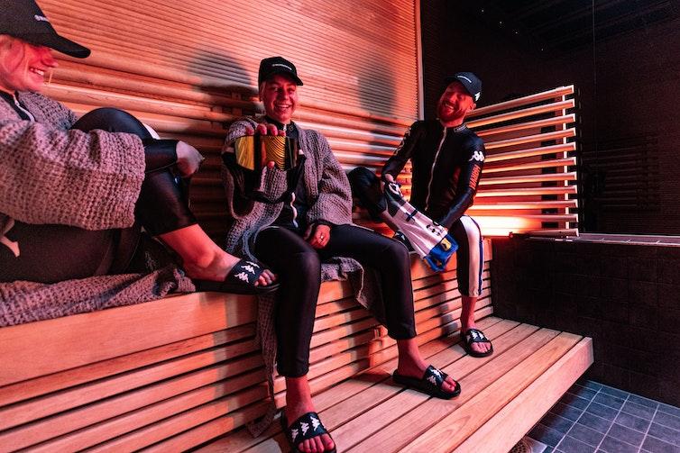 Alpine skiers in sauna