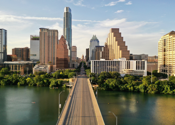 A photo of downtown Austin with view of Capitol building taken from South Congress Bridge