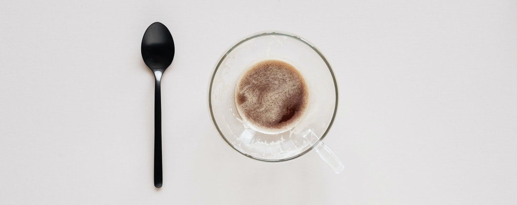 a cup of coffee and a spoon