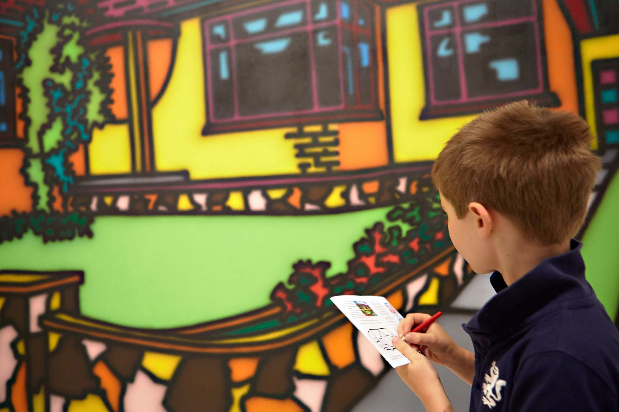 A young visitor with Howard Arkley's 1987 painting Triple fronted, Art Gallery of New South Wales © The Estate of Howard Arkley, courtesy Kalli Rolfe Contemporary Art