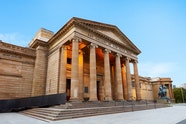 Exterior views of the Art Gallery of NSW at dawn.