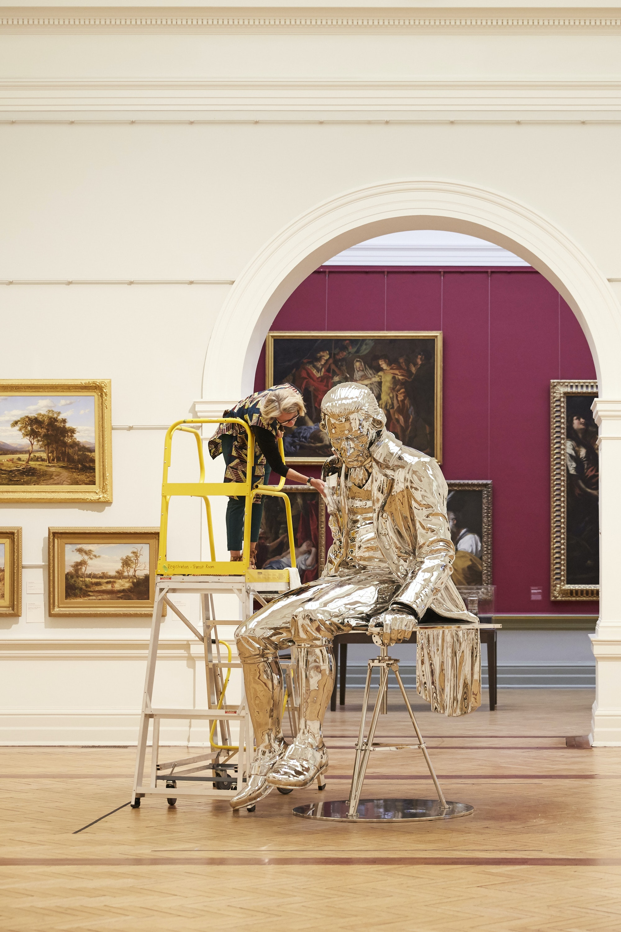 Objects conservator Kerry Head cleans Michael Parekowhai's 2015 sculpture The English Channel.