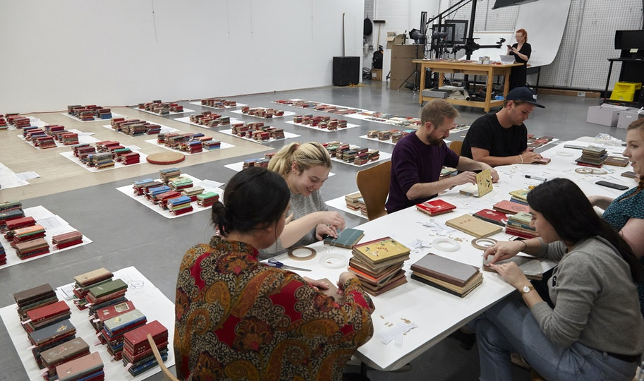 Assessing the condition and cataloguing a complex artwork requires teamwork. Paper conservator Sarah Bunn co-ordinates a group of staff and volunteers to check the 3000 notebooks that comprise AGNSW collection artwork Chinese Bible, 2009, Yang Zhichao.