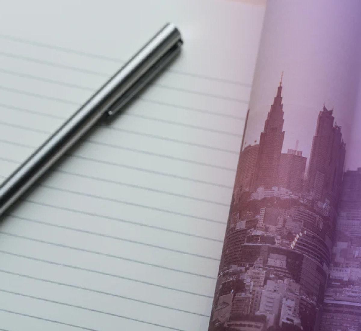 A photograph of a pen on an open notebook