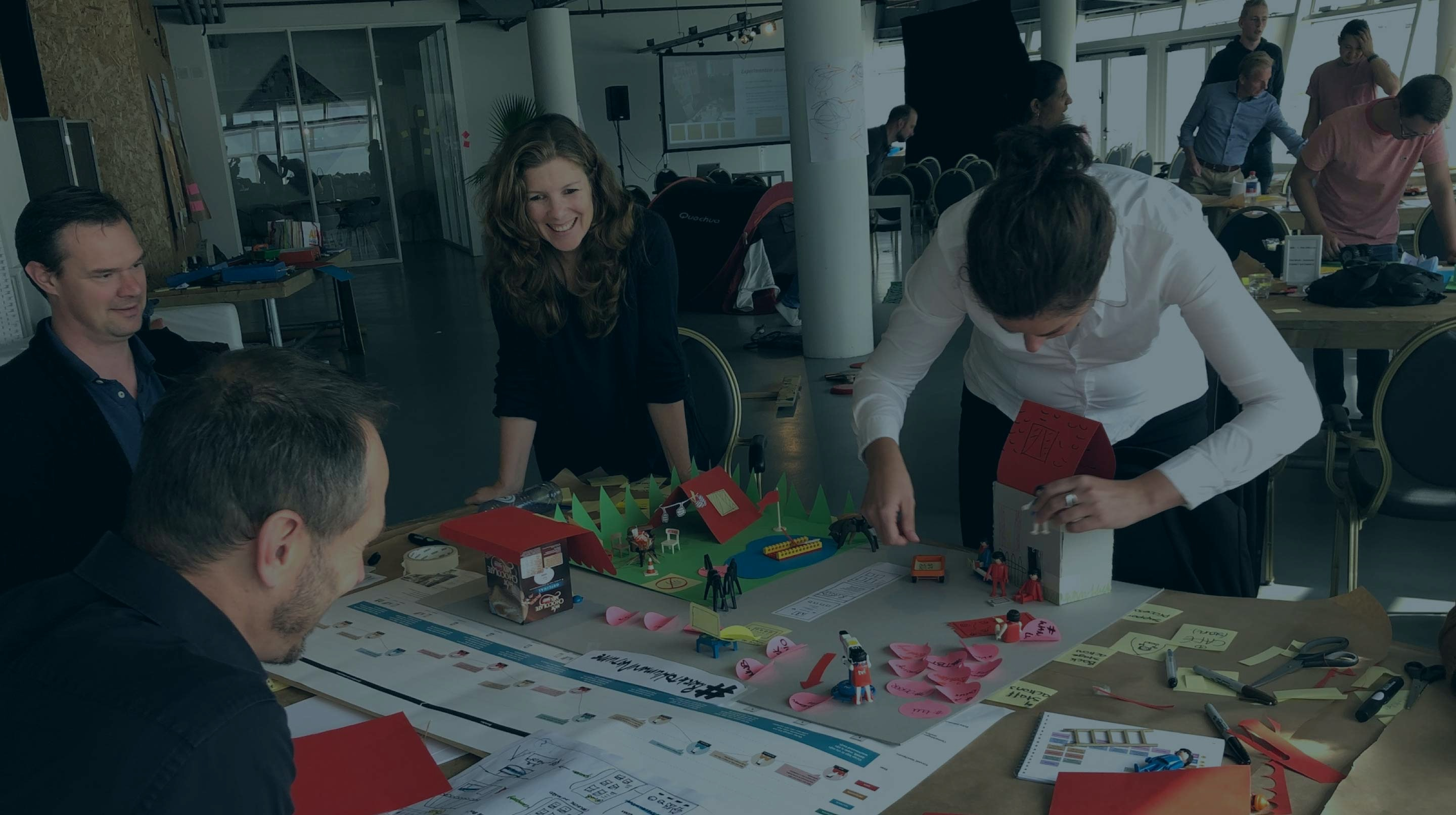 Attendees at a Service Design masterclass, creating a prototype