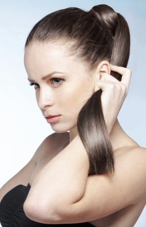woman holding hair - photo