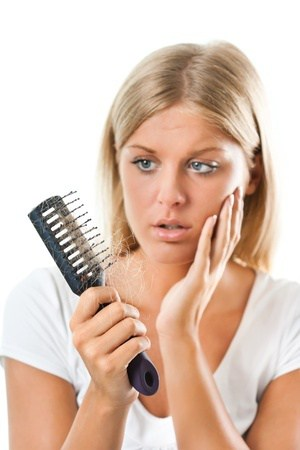 woman with comb - photo