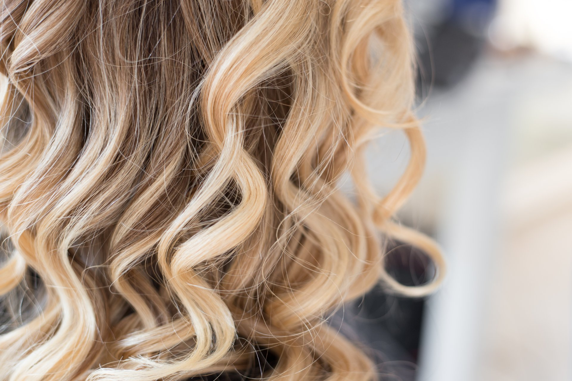 Lady with curly blonde highlighted hair