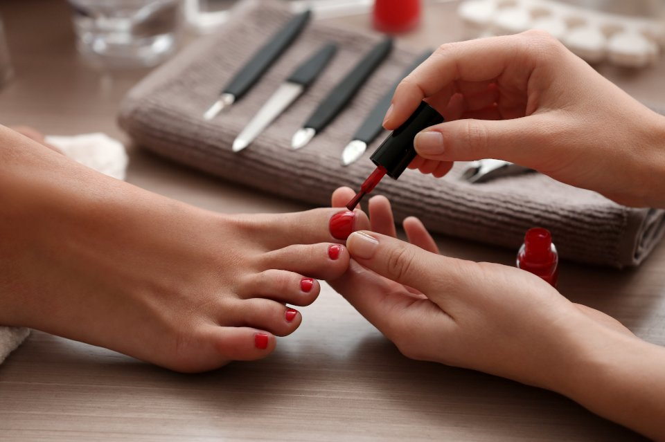 Woman receiving a pedicure at home
