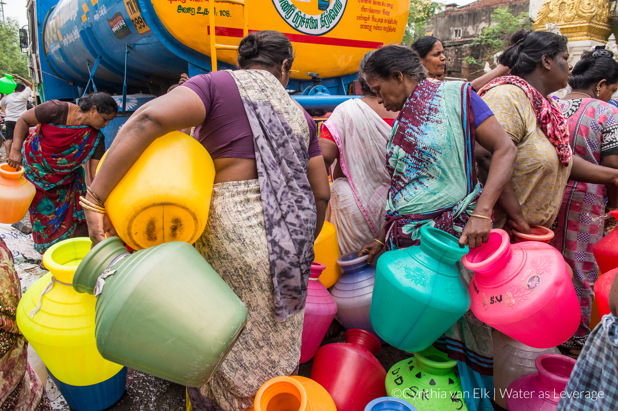 Women collecting water from a tank